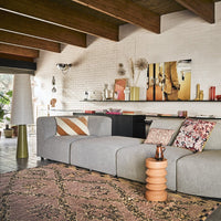 grey sofa with small terracotta side table