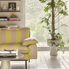 striped sofa with metal side table in cream