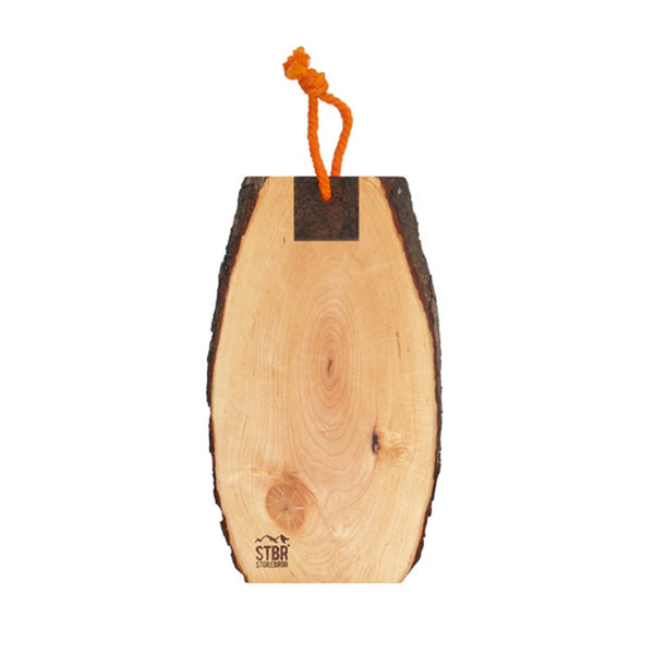 cutting board with bark and orange hanging rope