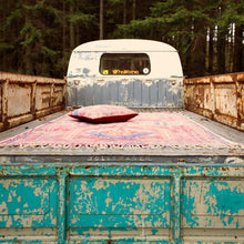 printed rug with vintage vibe in the truck of a volkwagen