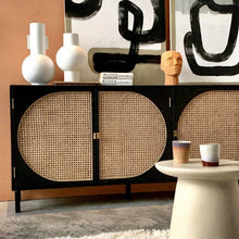 black sideboard with canewebbing detail doors