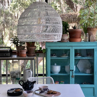 covered porch with white hanging basket light and turquoise cabinet