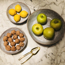large and medium grey organic shaped bowls with fruit and nuts