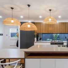 kitchen with 3 flat wicker lights hanging over kitchen island