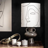 charcoal base and printed faces lampshade combination