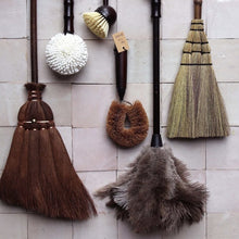 stylish flat lay of dust brushes and brooms