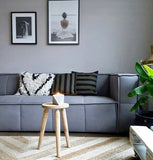 grey couch with striped throw pillows