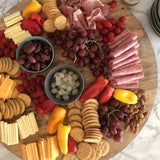 extra large wooden serving board with charcuterie
