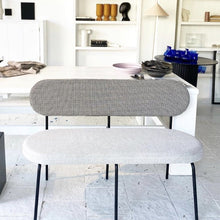 grey bench with two different fabrics in casual setting