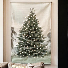 wall hanging of pine tree on printed cotton with led lights placed behind it