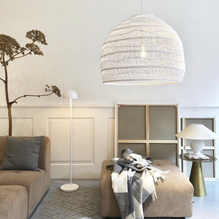 large white wicker basket pendant light with element sofa and white walls