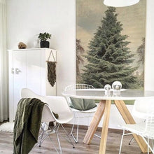 dining room in scandi style with large pinetree wall hanging