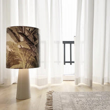 table lamp with jungle print and grey base on floor in living room