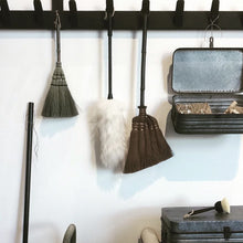 stylish dust brushes on a rack