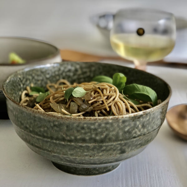ceramic noodle bowl with whole grain noodles