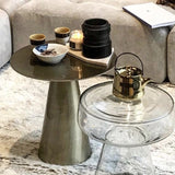 close up of brass cone shaped leg accent table