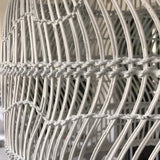close up of white wicker basket light