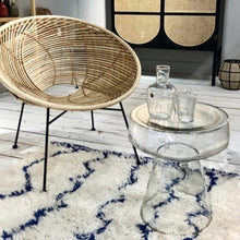 glass side table and wicker lounge chair