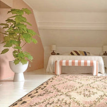 orange and pink Berber rug in bedroom