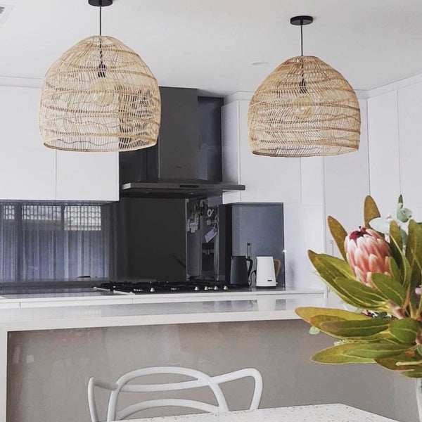 open kitchen with two medium wicker lights natural over a counter island