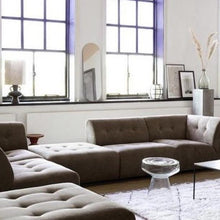 brown vint element sofa and glass side accent table