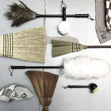 flatlay of stylish dust brushes