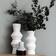 white vase together with brown blu vase