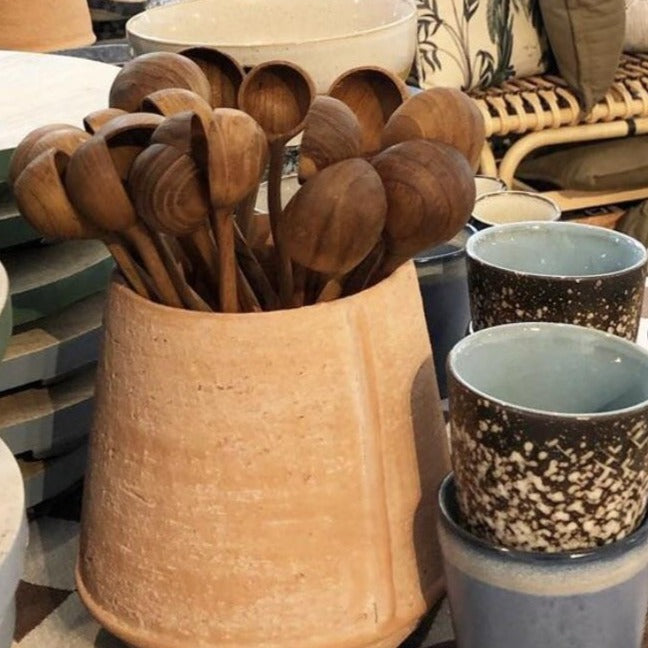 organic shaped wooden spoons in terracotta pot