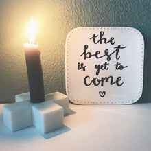 marble candle stick holder with burning candle and letter signage