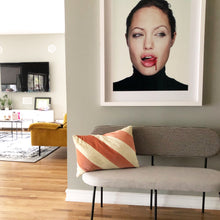 living room with art work photo of Angelina Jolie and hkliving grey bench