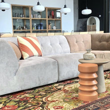 casual looking lounge room with large sofa and severel side tables