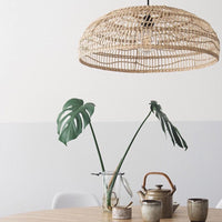 table with ceramics and natural wicker flat pendant light