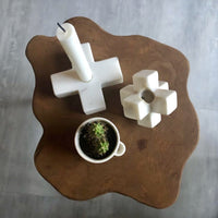 wooden table with marble candle stick holders seen from the top