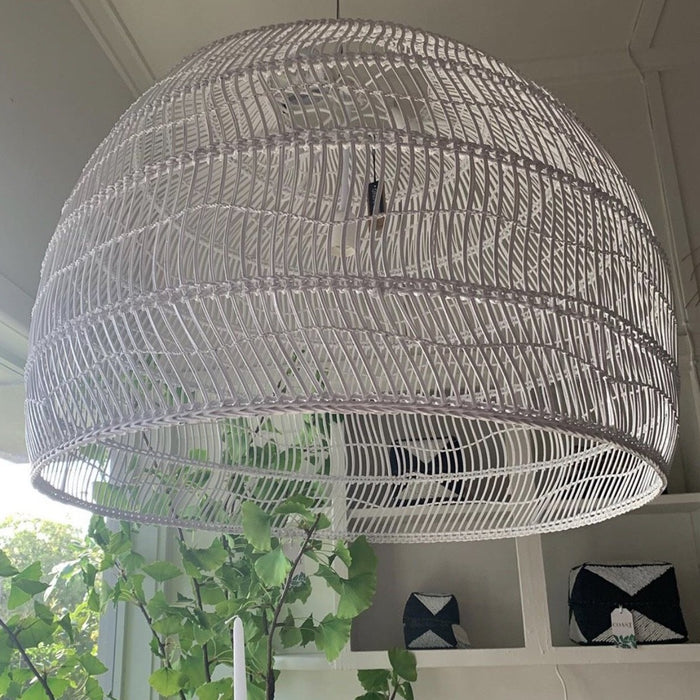 close up of xl white wicker hanging basket light