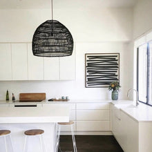 medium blavk wicker pendant in white kitchen