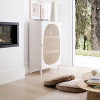living room with modern fire place and white single door cabinet