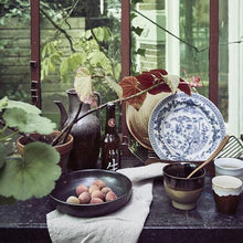 dispaly setting with kyoto ceramics and plants