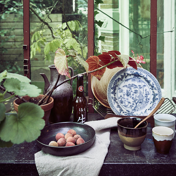 setting in kitchen with plates in the hk living usa kyoto line