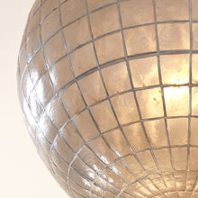 detail of large grey mother of pearl shell lamp with light on 60W
