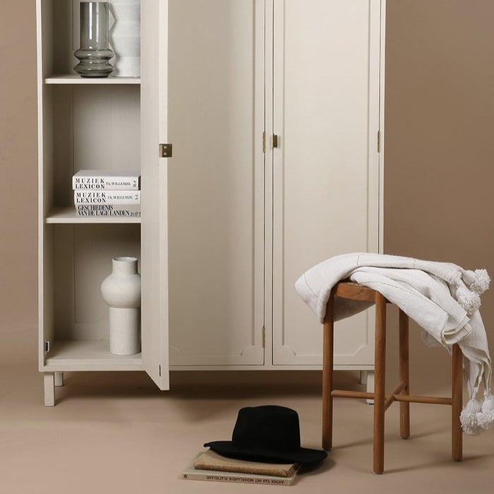 white cabinet and natural wooden cane webbing stool