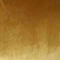 close up of the velvet from sofa in gold ochre