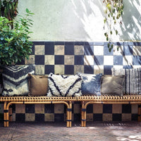 rattan bench with printed cushions