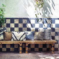 rattan benches with a variation of pillows printed and cotton