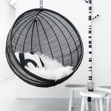 hanging chair round black rattan with sheepskin