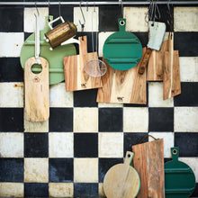 checkered back splash in black and white with wooden cutting boards on rack