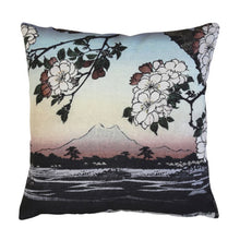 printed throw pillow with landscape and flowers in pastel colors