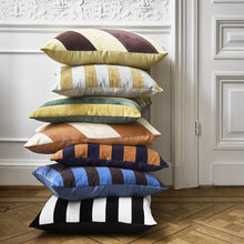 stack of velvet striped throw pillows in different color combinations