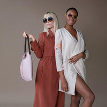 two ladies, one pink bag
