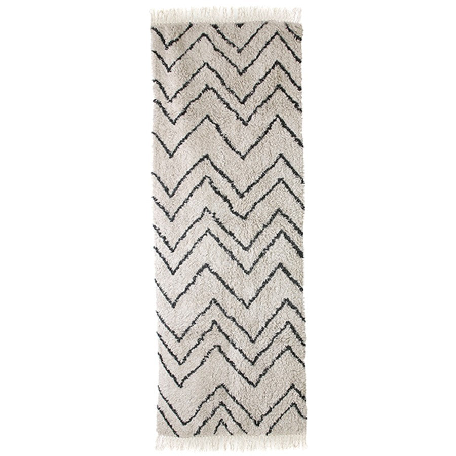 long cotton runner with black and white zig zag pattern and fringes