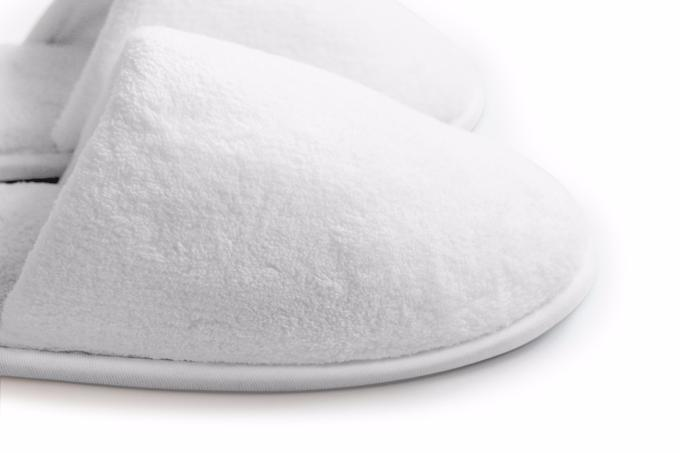 House shoes made with plush white coral fleece, comfortable padded soles, and safe non-skid surfaces. Love White Slippers is the only subscription services that delivers plush white slippers – with free shipping – to your home.